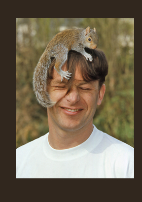 Chris Packham with Squirrell on his head