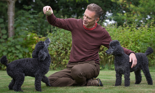 Chris with Itchy & Scratchy - image courtesy of Hearing Dogs for the Deaf